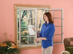 Lady-Cleaning-Sliding-Window